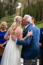 Father kissing bride wedding ceremony