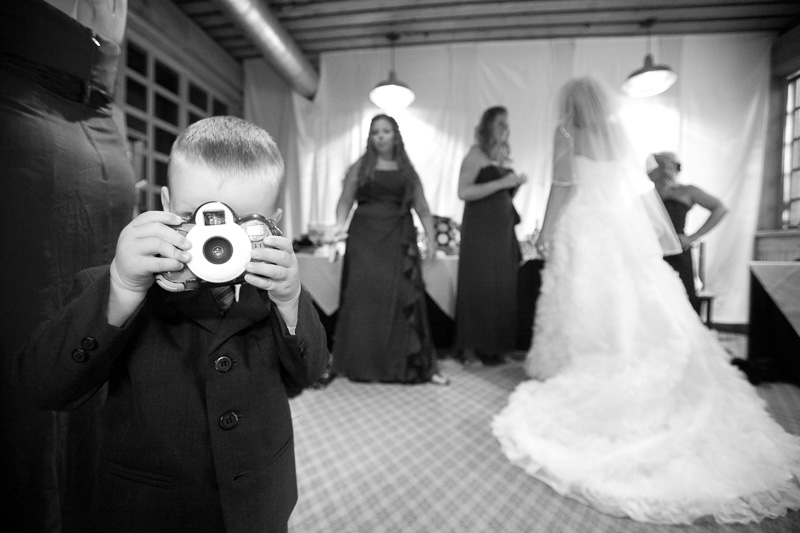 Ring bearer with his own camera at a wedding in Breckenridge, Colorado