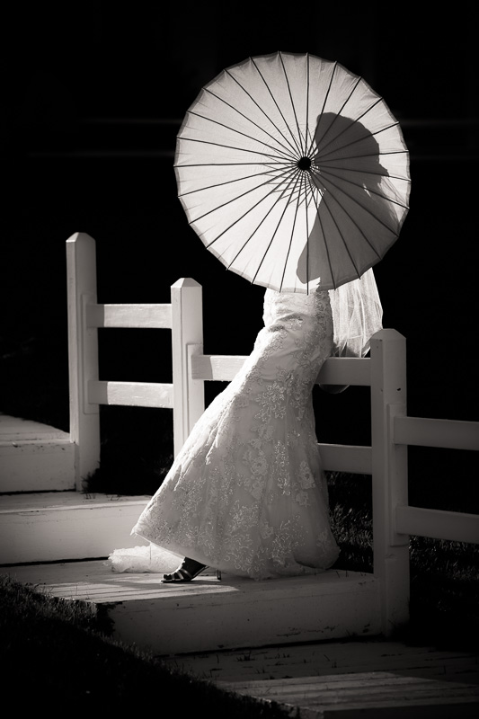 Bride and her parasol at dusk