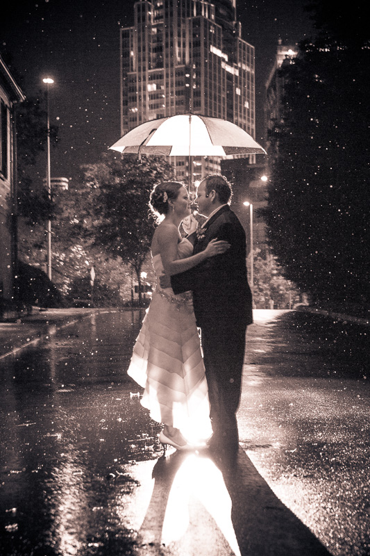 Bride and groom portrait in the rain