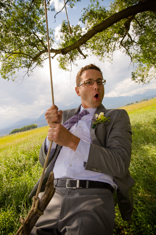 A groom on a tire swing in Salida, Colorado