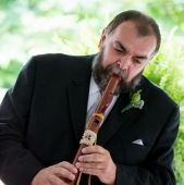 Father of the groom playing the Native American Flute