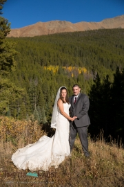 bride and groom in the mountains