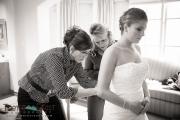 Both moms lacing the wedding dress