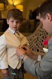 Groom helping his son get dressed