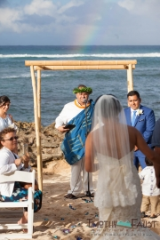 Bride walking down the aisle with rainbow