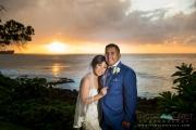 Bride and groom sunset portrait