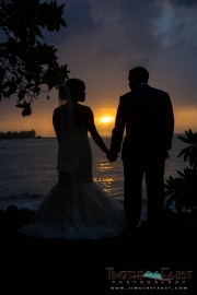 Bride and groom silhouette sunset portrait