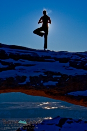 Mari doing yoga on Mesa Arch