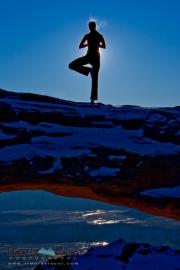 Mari doing yoga on Mesa Arch