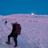 Moonset and climbers on Mount Ranier