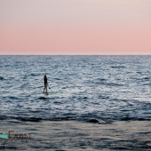 Stand up paddle boarder in Pacific Ocean