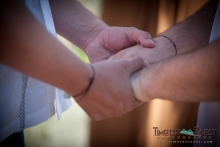 Grooms holding hands during ceremony