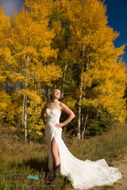 Bride and aspen trees in fall