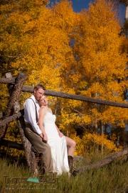 Bride and groom fall aspen trees