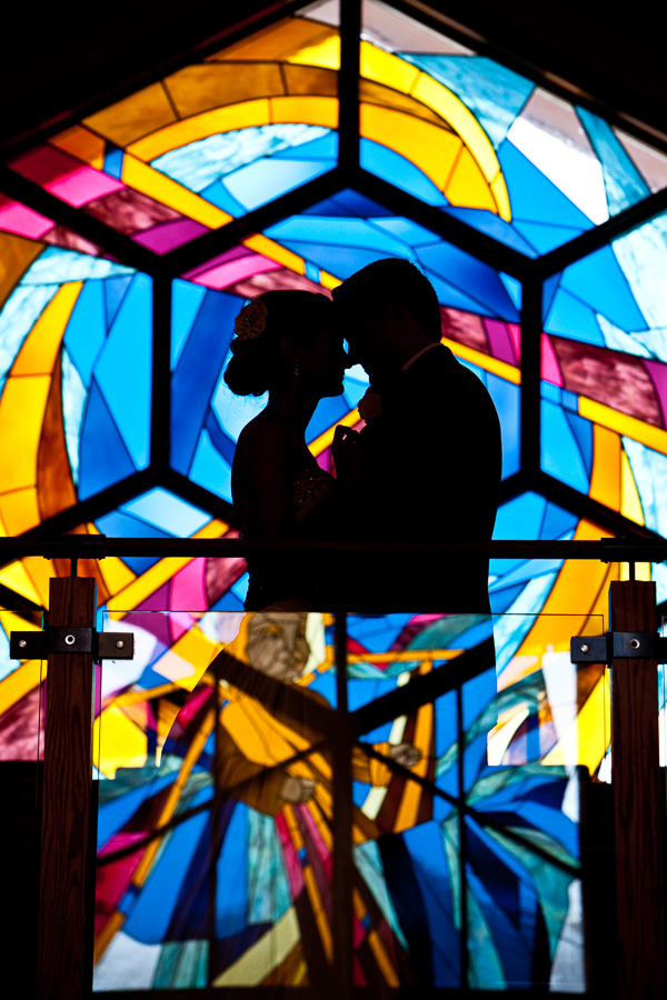Newlyweds in front of stained glass