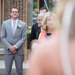 Groom seeing the bride walk down the aisle