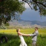 Bride and groom playing in a field