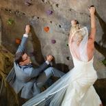 The bride and groom like to climb