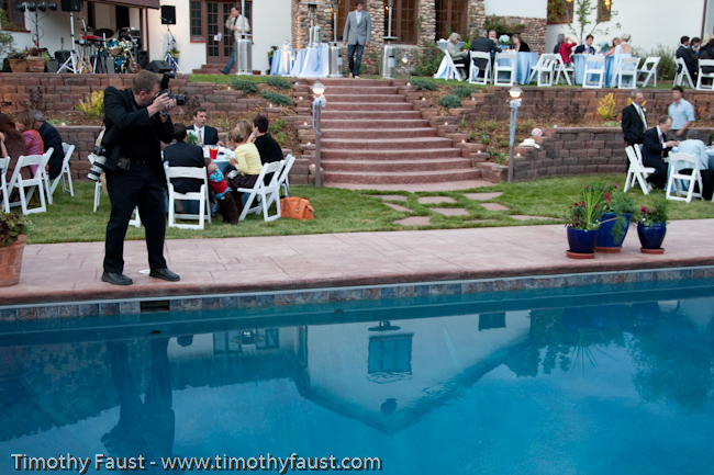 Timothy photographing at a wedding